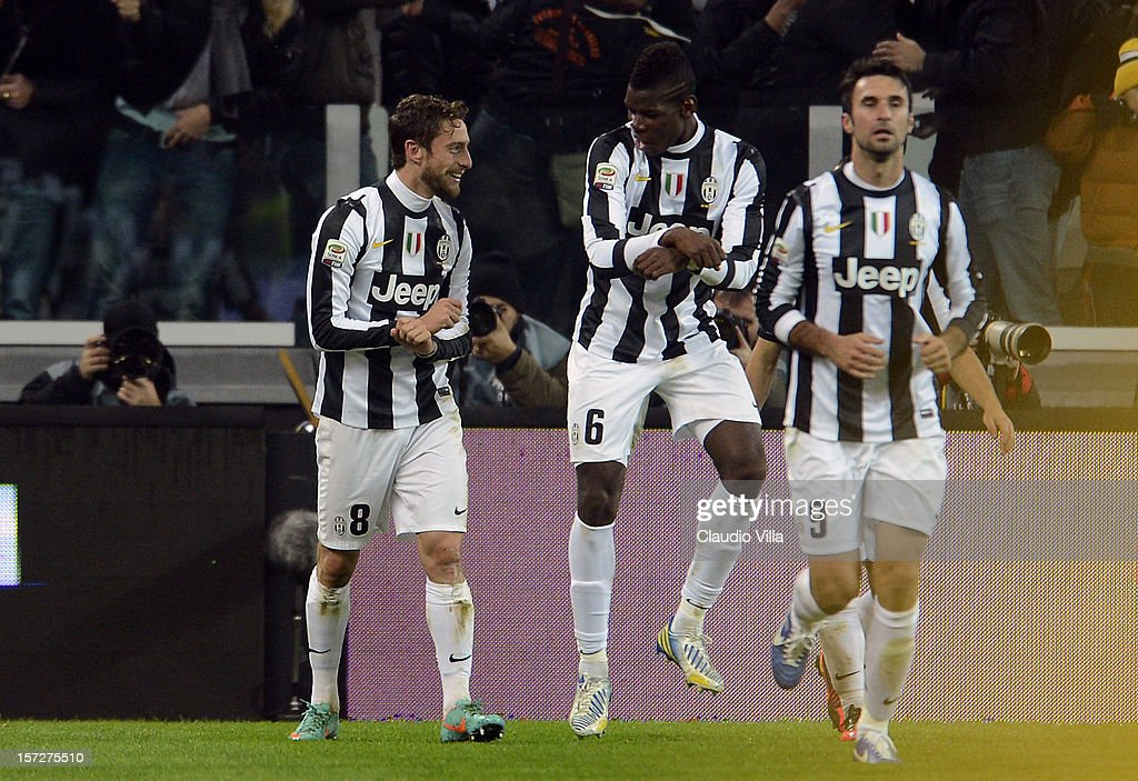 <a gi-track='captionPersonalityLinkClicked' href=/galleries/search?phrase=Claudio+Marchisio&family=editorial&specificpeople=4604252 ng-click='$event.stopPropagation()'>Claudio Marchisio</a> of Juventus FC #8 celebrates scoring the first goal during the Serie A match between Juventus and Torino FC at Juventus Arena on December 1, 2012 in Turin, Italy.