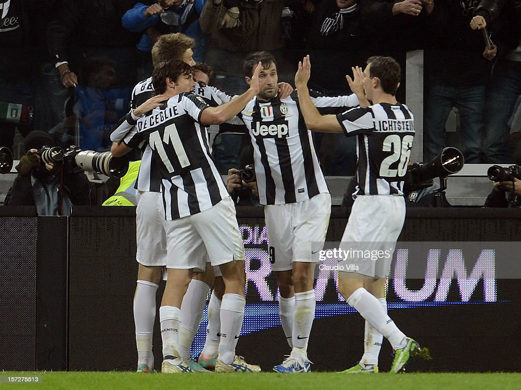 <a gi-track='captionPersonalityLinkClicked' href=/galleries/search?phrase=Claudio+Marchisio&family=editorial&specificpeople=4604252 ng-click='$event.stopPropagation()'>Claudio Marchisio</a> of Juventus FC (C) celebrates scoring the first goal during the Serie A match between Juventus and Torino FC at Juventus Arena on December 1, 2012 in Turin, Italy.