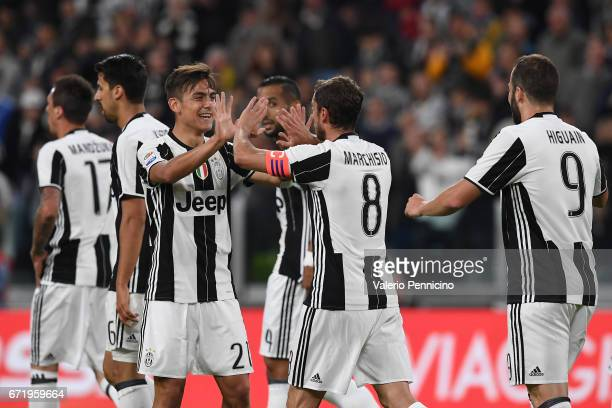 Claudio Marchisio of Juventus FC celebrates the opening goal with team mate Paulo Dybala during the Serie A match between Juventus FC and Genoa CFC...