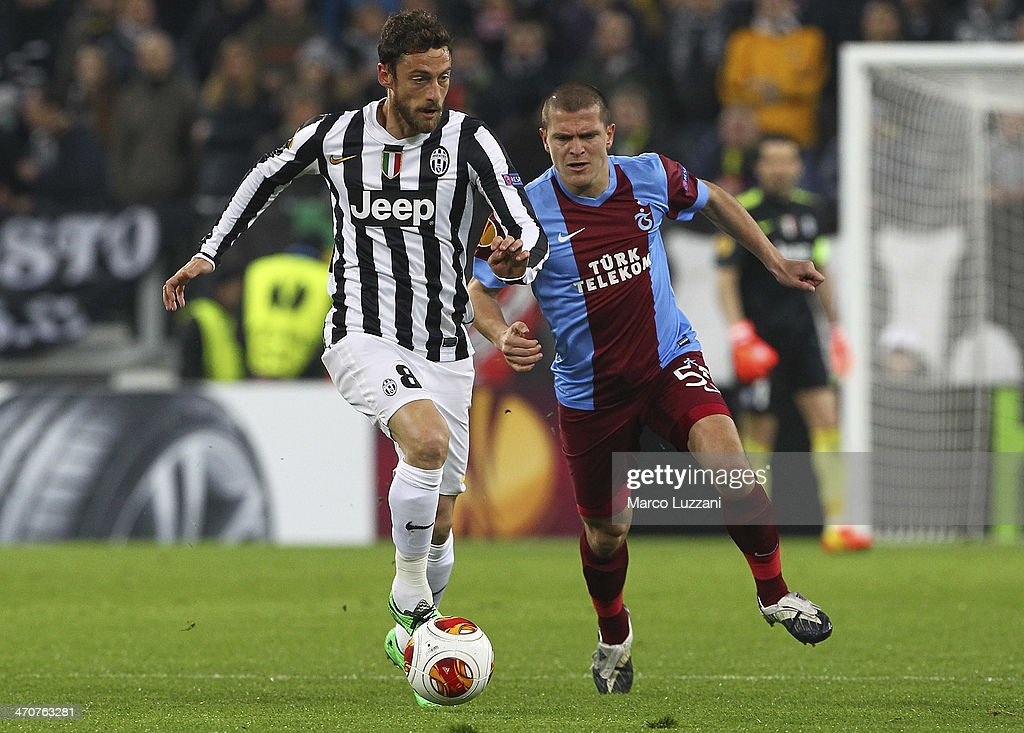 <a gi-track='captionPersonalityLinkClicked' href=/galleries/search?phrase=Claudio+Marchisio&family=editorial&specificpeople=4604252 ng-click='$event.stopPropagation()'>Claudio Marchisio</a> (L) of Juventus FC competes for the ball with <a gi-track='captionPersonalityLinkClicked' href=/galleries/search?phrase=Alexandru+Bourceanu&family=editorial&specificpeople=6597771 ng-click='$event.stopPropagation()'>Alexandru Bourceanu</a> of AS Trabzonspor during the UEFA Europa League Round of 32 match between Juventus and AS Trabzonspor at Juventus Arena on February 20, 2014 in Turin, Italy.
