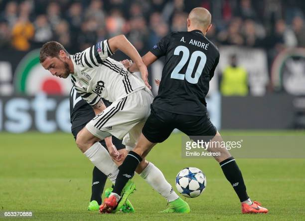 Claudio Marchisio of Juventus FC competes for the ball with Andre Andre of FC Porto during the UEFA Champions League Round of 16 second leg match...