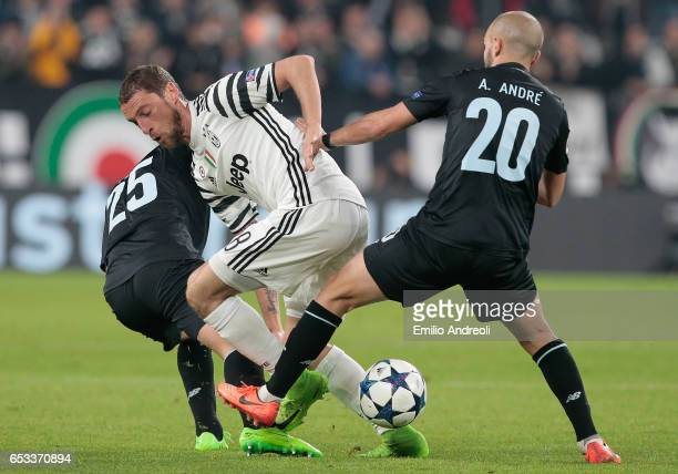Claudio Marchisio of Juventus FC competes for the ball with Andre Andre of FC Porto and Otavio of FC Porto during the UEFA Champions League Round of...