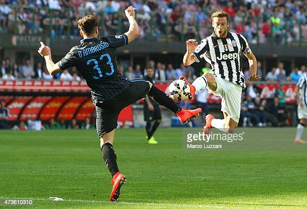 Claudio Marchisio of Juventus FC competes for the ball with Danilo D Amombrosio of FC Internazionale Milano during the Serie A match between FC...