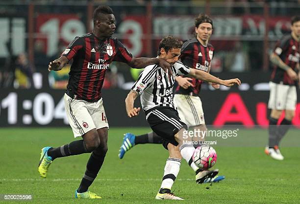 Claudio Marchisio of Juventus FC competes for the ball with Mario Balotelli of AC Milan during the Serie A match between AC Milan and Juventus FC at...