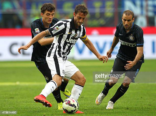 Claudio Marchisio of Juventus FC competes for the ball with Mateo Kovacic and Rodrigo Palacio of FC Internazionale Milano during the Serie A match...