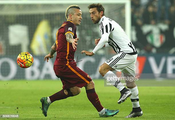 Claudio Marchisio of Juventus FC competes for the ball with Radja Nainggolan of AS Roma during the Serie A match between Juventus FC and AS Roma at...