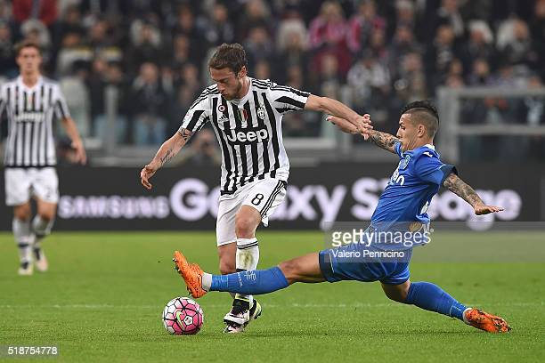 Claudio Marchisio of Juventus FC is tackled by Leandro Paredes of Empoli FC during the Serie A match between Juventus FC and Empoli FC at Juventus...