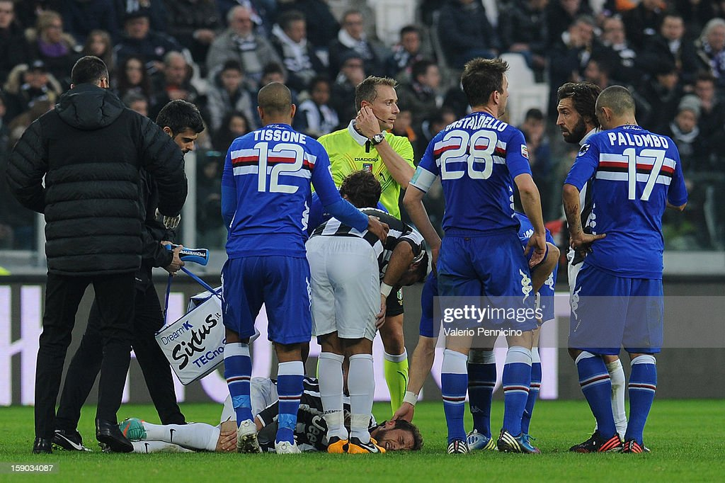 Claudio Marchisio of Juventus FC lies injured during the Serie A match between Juventus FC and UC Sampdoria at Juventus Arena on January 6, 2013 in Turin, Italy.