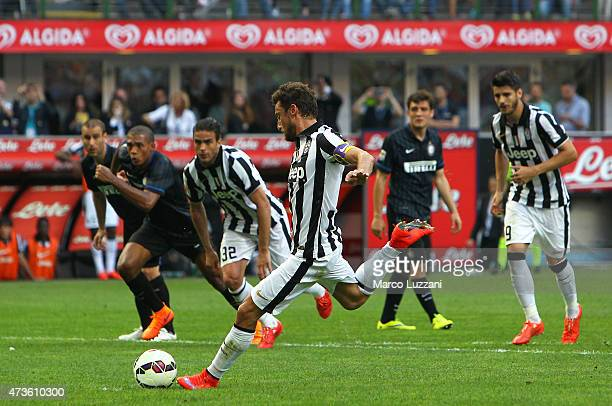 Claudio Marchisio of Juventus FC scores his goal from the penalty spot during the Serie A match between FC Internazionale Milano and Juventus FC at...