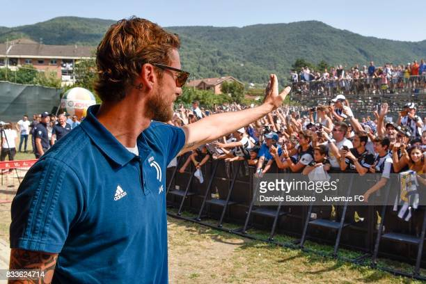 Claudio Marchisio of Juventus greets fans during the preseason friendly match between Juventus A and Juventus B on August 17 2017 in Villar Perosa...