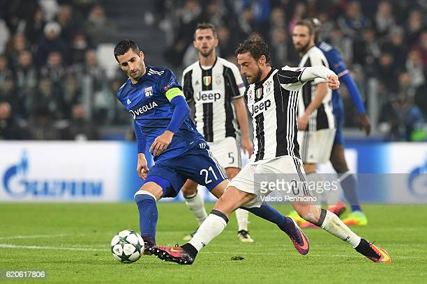 Claudio Marchisio of Juventus in action against Maxime Gonalons of Olympique Lyonnais during the UEFA Champions League Group H match between Juventus...
