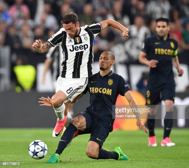 Claudio Marchisio of Juventus is challenged by Fabinho of Monaco during the UEFA Champions League Semi Final second leg match between Juventus and AS...