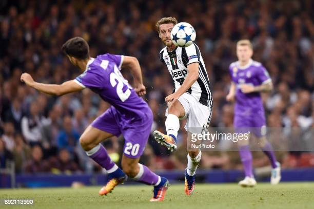 Claudio Marchisio of Juventus is challenged by Isco of Real Madrid during the UEFA Champions League Final match between Real Madrid and Juventus at...