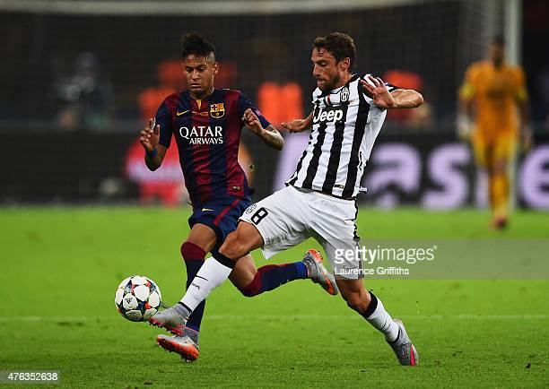 Claudio Marchisio of Juventus is closed down by Neymar of Barcelona during the UEFA Champions League Final between Juventus and FC Barcelona at...
