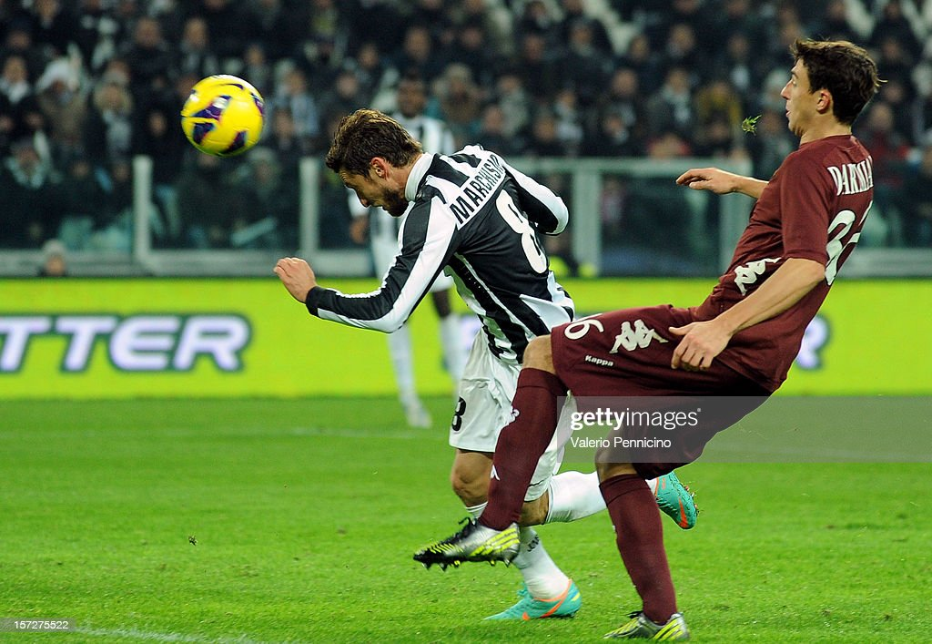 <a gi-track='captionPersonalityLinkClicked' href=/galleries/search?phrase=Claudio+Marchisio&family=editorial&specificpeople=4604252 ng-click='$event.stopPropagation()'>Claudio Marchisio</a> (L) of Juventus scores the opening goal during the Serie A match between Juventus and Torino FC at Juventus Arena on December 1, 2012 in Turin, Italy.