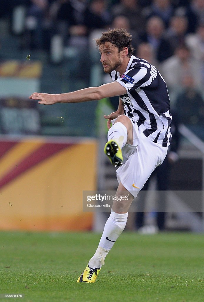 Claudio Marchisio of Juventus scores the second goal during the UEFA Europa League quarter final match between Juventus and Olympique Lyonnais at Juventus Arena on April 10, 2014 in Turin, Italy.
