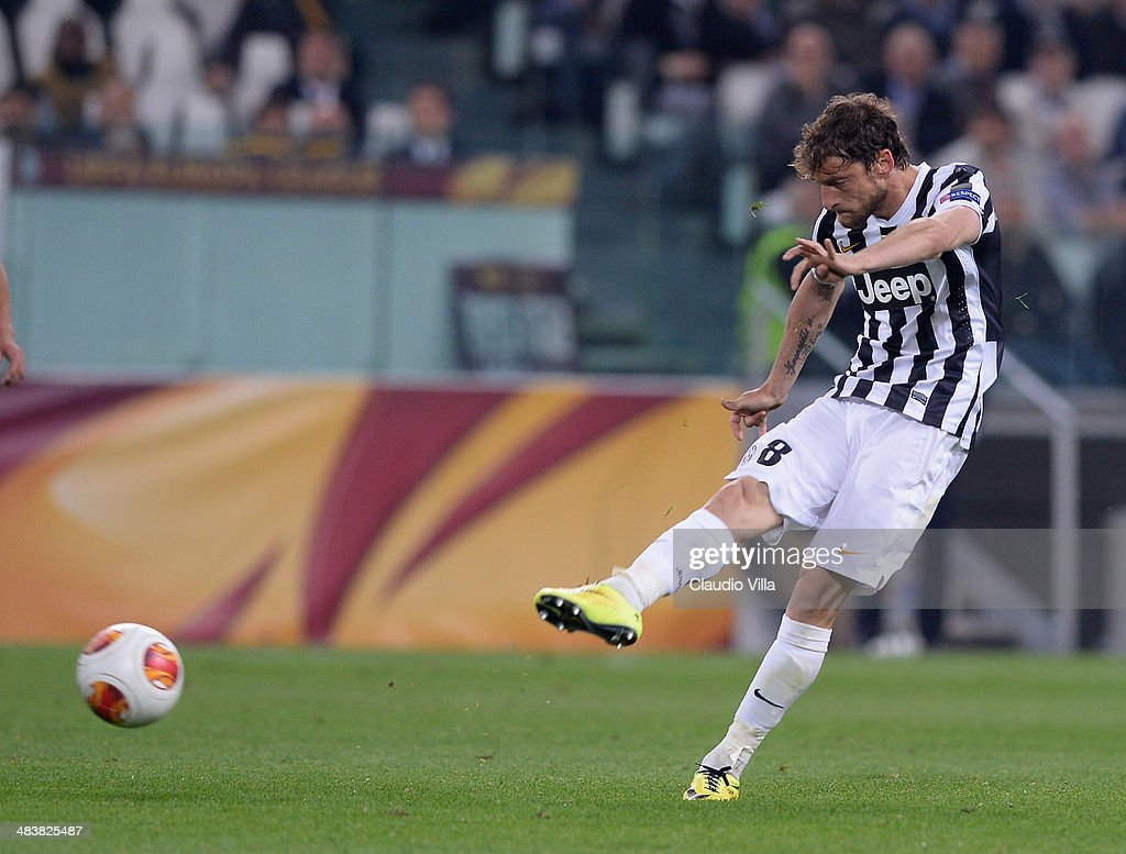 <a gi-track='captionPersonalityLinkClicked' href=/galleries/search?phrase=Claudio+Marchisio&family=editorial&specificpeople=4604252 ng-click='$event.stopPropagation()'>Claudio Marchisio</a> of Juventus scores the second goal during the UEFA Europa League quarter final match between Juventus and Olympique Lyonnais at Juventus Arena on April 10, 2014 in Turin, Italy.