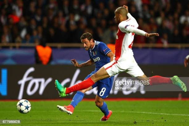 Claudio Marchisio of Juventus shoots on goal under pressure from Fabinho of AS Monaco during the UEFA Champions League Semi Final first leg match...