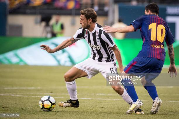 Claudio Marchisio of Juventus tries to keep the ball away from Lionel Messi of Barcelona during the International Champions Cup match between FC...