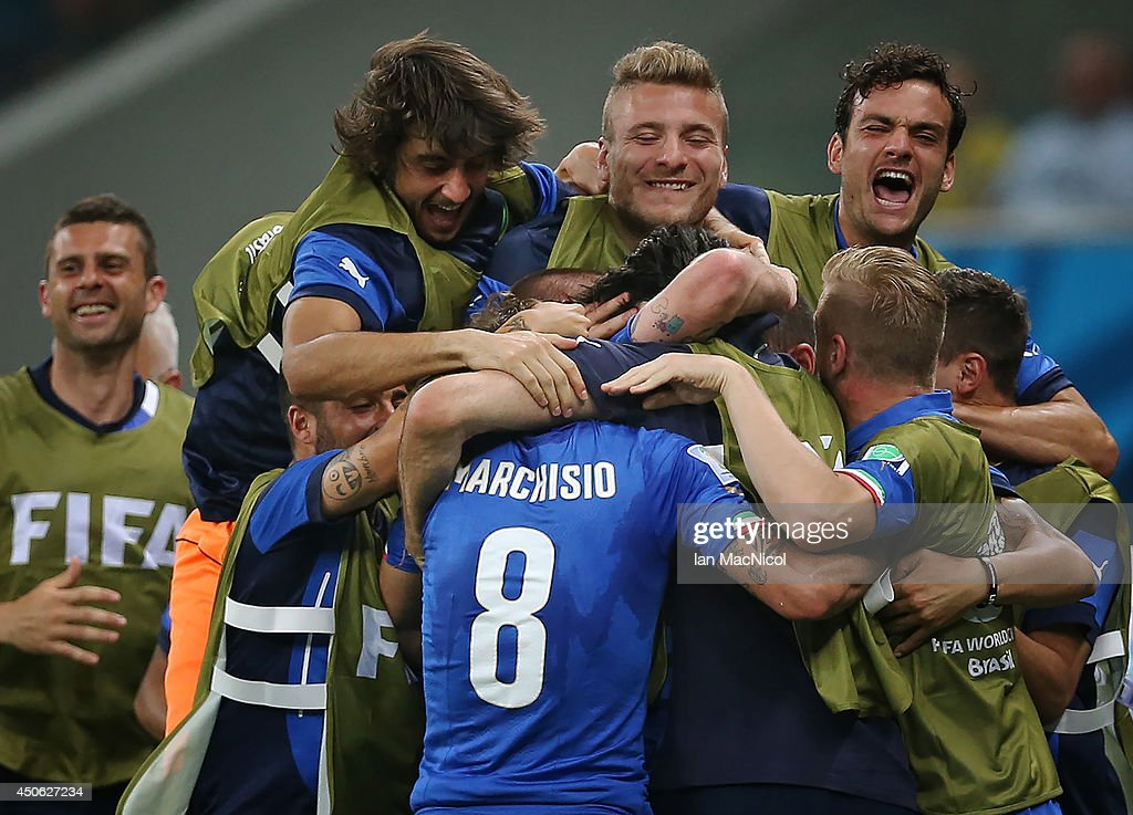 Claudio Marchisio runs to celebrate with the bench after scoring during the opening Group D match of the 2014 World Cup between England and Italy at Arena Amazonia on June 14, 2014 in Manaus, Brazil.