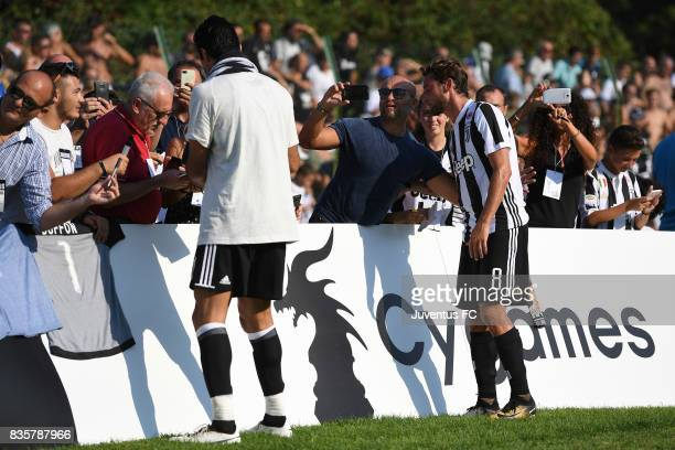 Claudio Marchisio takes a selfie with fans during the preseason friendly match between Juventus A and Juventus B on August 17 2017 in Villar Perosa...