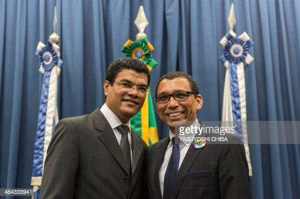 Claudio Nascimento an LGBT activist of Rio de Janeiro State poses with his partner Joao Silva after the wedding ceremony at the Court of Justice of...