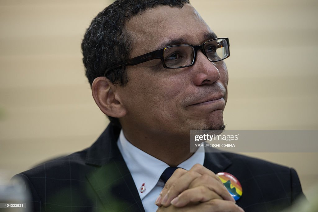 Claudio Nascimento, an LGBT activist of Rio de Janeiro State, reacts after his speech after the wedding ceremony at the Court of Justice of the State of Rio de Janeiro in Rio de Janeiro, Brazil, on December 8, 2013. 130 gay couples are getting married in the first massive wedding ceremony since the first gay marriage in Rio de Janeiro in 2011.