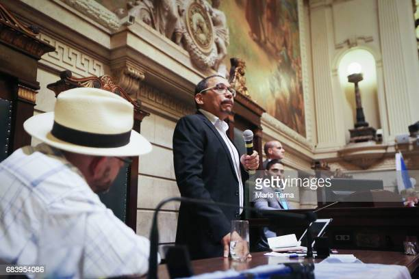 Claudio Nascimento one of the founders of the Rio gay pride parade speaks at a protest held inside city council on May 16 2017 in Rio de Janeiro...
