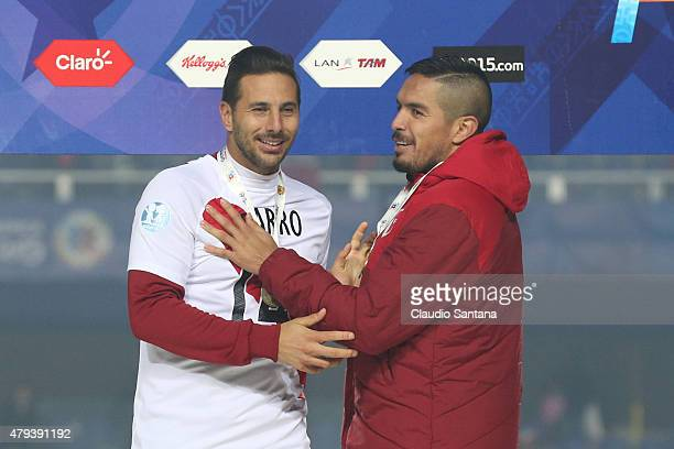 Claudio Pizarro and Juan Vargas of Peru celebrate with their third place medals after the 2015 Copa America Chile Third Place Playoff match between...