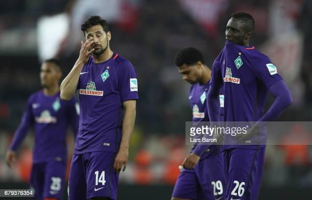 Claudio Pizarro and Lamine Sané of Bremen look disappointed after the Bundesliga match between 1 FC Koeln and Werder Bremen at RheinEnergieStadion on...