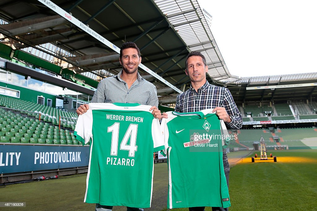 Claudio Pizarro and Manager Thomas Eichin poses during the press conference of Werder Bremen at Weserstadion on September 7 2015 in Bremen Germany