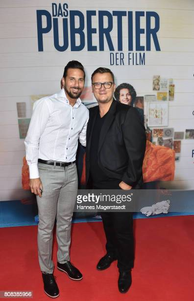 Claudio Pizarro and Torsten Koch during the 'Das Pubertier' Premiere at Mathaeser Filmpalast on July 4 2017 in Munich Germany