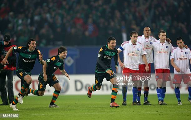 Claudio Pizarro Diego and Mesut Oezil of Bremen celebrate after the DFB Cup Semi Final match between Hamburger SV and SV Werder Bremen at the HSH...