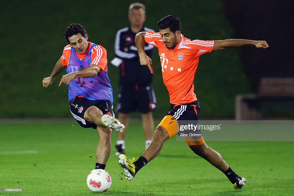 Claudio Pizarro (L) is challenged by Emre Can during a Bayern Muenchen training session at the ASPIRE Academy for Sports Excellence on January 3, 2013 in Doha, Qatar.