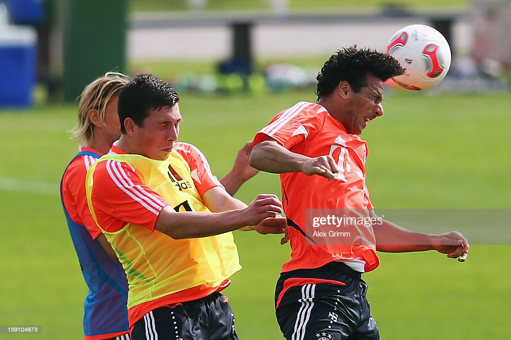 Claudio Pizarro jumps for a header with Pierre-Emile Hojbjerg and Anatoliy Tymoshchuk (R-L) during a Bayern Muenchen training session at the ASPIRE Academy for Sports Excellence on January 8, 2013 in Doha, Qatar.