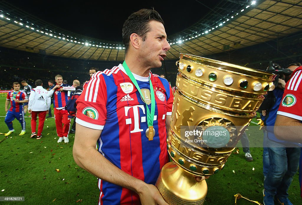 <a gi-track='captionPersonalityLinkClicked' href=/galleries/search?phrase=Claudio+Pizarro&family=editorial&specificpeople=217807 ng-click='$event.stopPropagation()'>Claudio Pizarro</a> of Bayern Muenchen celebrates after winning the DFB Cup Final match between Borussia Dortmund and FC Bayern Muenchen at Olympiastadion on May 17, 2014 in Berlin, Germany.