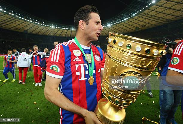 Claudio Pizarro of Bayern Muenchen celebrates after winning the DFB Cup Final match between Borussia Dortmund and FC Bayern Muenchen at...