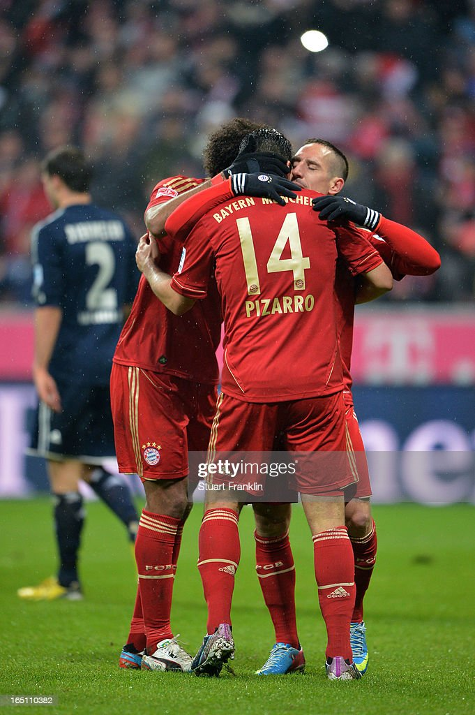 Claudio Pizarro of Bayern Muenchen celebrates his fourth goal and his team's eighth with Franck Ribery during the Bundesliga match between FC Bayern Muenchen and Hamburger SV at Allianz Arena on March 30, 2013 in Munich, Germany.