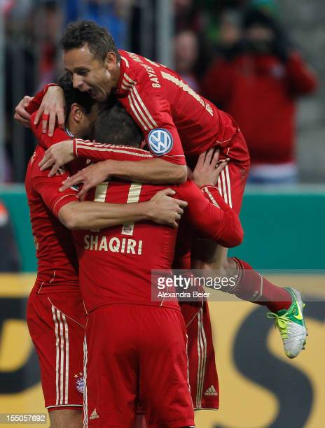 Claudio Pizarro of Bayern Muenchen celebrates his team's first goal together with his teammates Xherdan Shaqiri and Rafinha during the DFB Cup second...