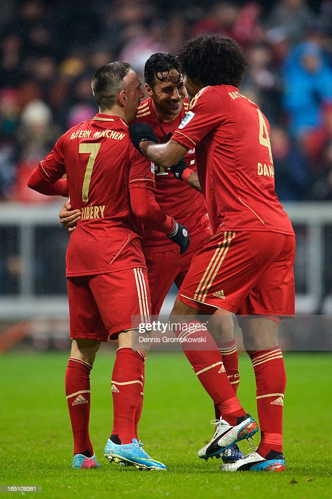 Claudio Pizarro (C) of Bayern Muenchen celebrates scoring his fourth goal and his team's eighth with Franck Ribery (L) and Dante during the Bundesliga match between FC Bayern Muenchen and Hamburger SV at Allianz Arena on March 30, 2013 in Munich, Germany.