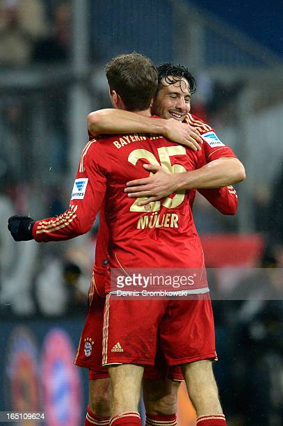 Claudio Pizarro of Bayern Muenchen celebrates scoring his fourth goal and his team's eighth with Thomas Mueller during the Bundesliga match between...
