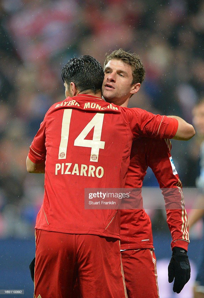 Claudio Pizarro of Bayern Muenchen celebrates scoring his fourth goal and his team's eighth with Thomas Mueller during the Bundesliga match between FC Bayern Muenchen and Hamburger SV at Allianz Arena on March 30, 2013 in Munich, Germany.