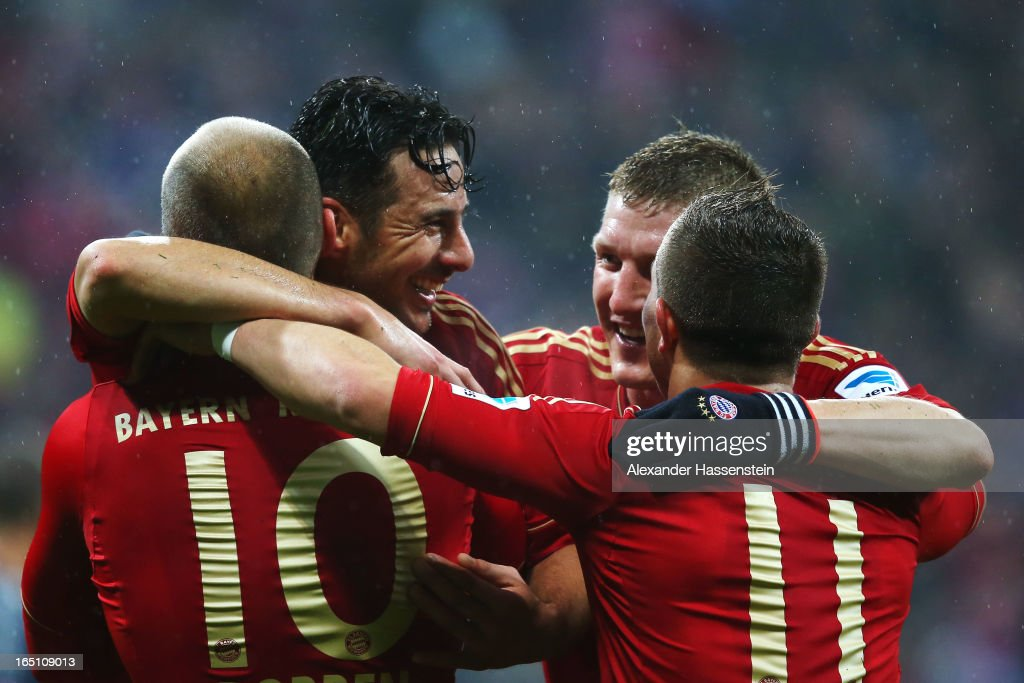 <a gi-track='captionPersonalityLinkClicked' href=/galleries/search?phrase=Claudio+Pizarro&family=editorial&specificpeople=217807 ng-click='$event.stopPropagation()'>Claudio Pizarro</a> of Bayern Muenchen celebrates scoring the fifth goal with <a gi-track='captionPersonalityLinkClicked' href=/galleries/search?phrase=Arjen+Robben&family=editorial&specificpeople=194740 ng-click='$event.stopPropagation()'>Arjen Robben</a>, <a gi-track='captionPersonalityLinkClicked' href=/galleries/search?phrase=Bastian+Schweinsteiger&family=editorial&specificpeople=203122 ng-click='$event.stopPropagation()'>Bastian Schweinsteiger</a> and <a gi-track='captionPersonalityLinkClicked' href=/galleries/search?phrase=Xherdan+Shaqiri&family=editorial&specificpeople=6923918 ng-click='$event.stopPropagation()'>Xherdan Shaqiri</a> during the Bundesliga match between FC Bayern Muenchen and Hamburger SV at Allianz Arena on March 30, 2013 in Munich, Germany.