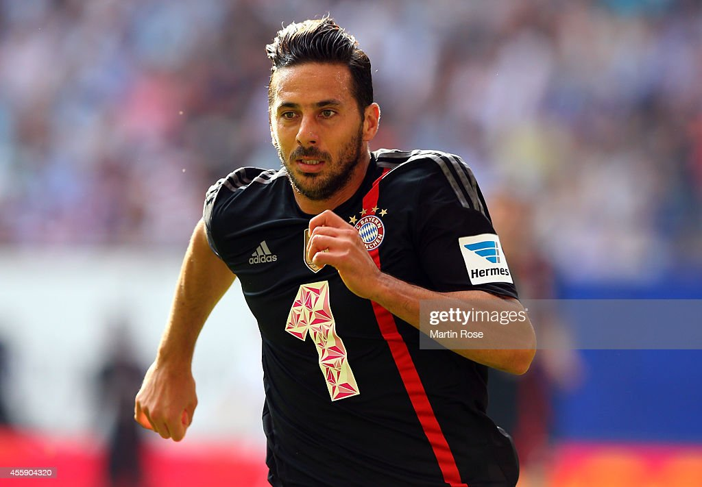 <a gi-track='captionPersonalityLinkClicked' href=/galleries/search?phrase=Claudio+Pizarro&family=editorial&specificpeople=217807 ng-click='$event.stopPropagation()'>Claudio Pizarro</a> of Bayern Muenchen runs with the ball during the Bundesliga match between Hamburger SV and FC Bayern Muenchen at Imtech Arena on September 20, 2014 in Hamburg, Germany.