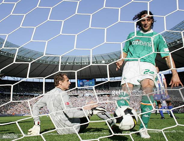 Claudio Pizarro of Bremen and Jaroslav Drobny of Bremen seen in action during the Bundesliga match between Hertha BSC Berlin and SV Werder Bremen at...