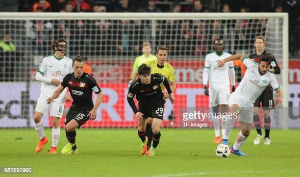 Claudio Pizarro of Bremen and Kai Havertz of Leverkusen and Julian Baumgartlinger battle for the ball during the Bundesliga soccer match between...