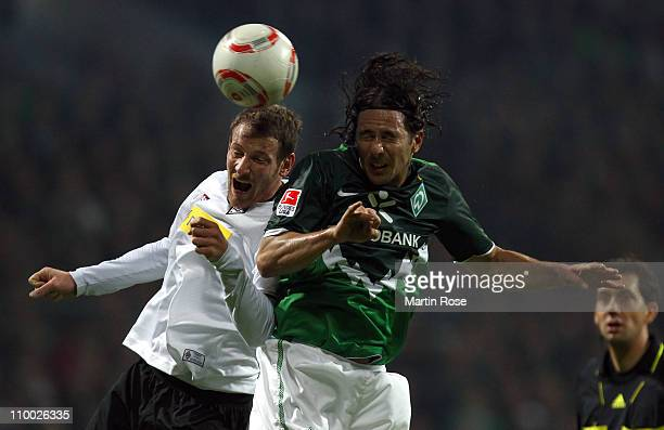 Claudio Pizarro of Bremen and Michael Fink of Gladbach battle for the ball during the Bundesliga match between Werder Bremen and Borussia M'gladbach...