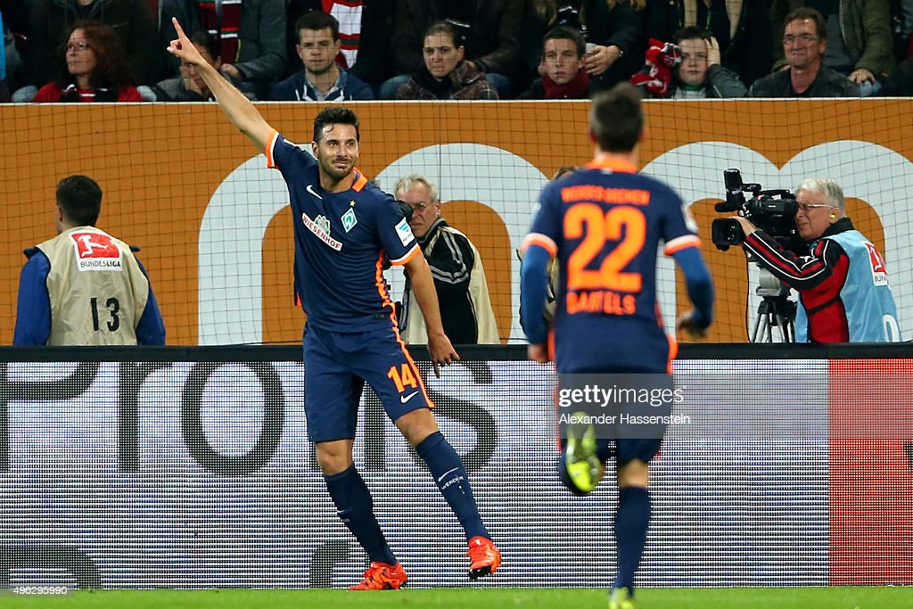 <a gi-track='captionPersonalityLinkClicked' href=/galleries/search?phrase=Claudio+Pizarro&family=editorial&specificpeople=217807 ng-click='$event.stopPropagation()'>Claudio Pizarro</a> of Bremen celebrate scoring the opening during the Bundesliga match between FC Augsburg and SV Werder Bremen at WWK Arena on November 8, 2015 in Augsburg, Germany.