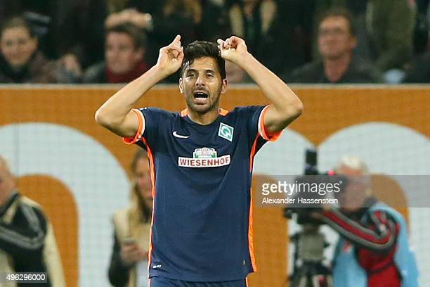 Claudio Pizarro of Bremen celebrate scoring the opening during the Bundesliga match between FC Augsburg and SV Werder Bremen at WWK Arena on November...