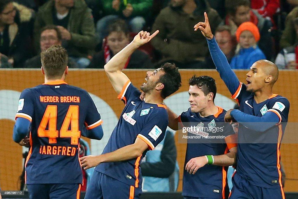Claudio Pizarro of Bremen celebrate scoring the opening goal with his team mates Zlatko Junuzovic and Theodor Gebre Selassi during the Bundesliga...